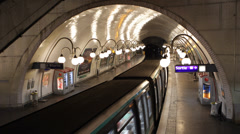 Paris Cite Metro Station Underground System Pedestrians Passing Commuters Lights - stock footage