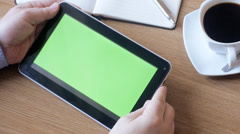 Man watching tablet with green screen in cafe - stock footage