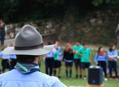 Chief scout with the typical hat while controlling their kids to camp Stock Photos