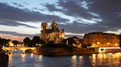 Illuminated Dusk Night Light Nighttime Famous Notre Dame Tour Boat passing Paris - stock footage