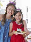 Two Smiling Girls In Tiaras - stock photo