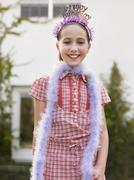 Cute Girl In Tiara And Feather Boa Stock Photos