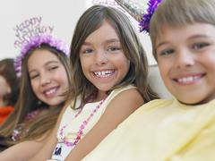Children In Row At Birthday Party - stock photo