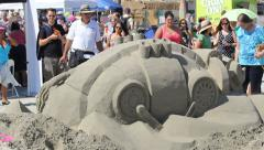 Steam Punk Sand Sculpture Artist and Crowd Stock Footage
