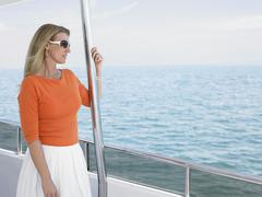 Woman Wearing Sunglasses On Yacht Stock Photos
