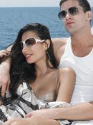 Couple Wearing Sunglasses On Yacht - stock photo