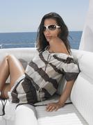 Stylish Woman Wearing Sunglasses On Yacht Stock Photos