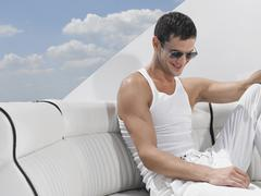 Young Man Relaxing On Sofa Of Yacht Stock Photos