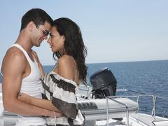 Couple Embracing On Yacht Stock Photos
