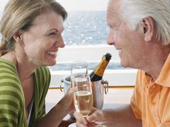 Happy Couple Drinking Champagne On Yacht Stock Photos