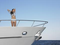Woman Standing In Bow Of Yacht Stock Photos