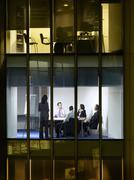 Business People In Meeting Room At Night Stock Photos