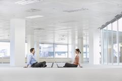 Business People With Laptops In Empty Office Space - stock photo