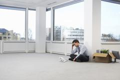 Tensed Businessman In Empty Office Space - stock photo