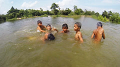 Cambodian kids playing in water Stock Footage