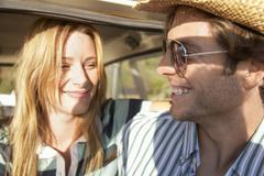 Stock Photo of Couple Smiling While Looking At Each Other