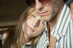 Woman Resting Head On Boyfriend's Shoulder Stock Photos