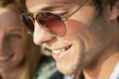 Smiling Young Man Wearing Sunglasses - stock photo