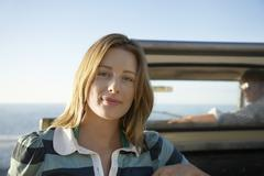 Woman Standing By Van With Ocean In Background Stock Photos