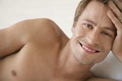 Shirtless Young Man Smiling - stock photo