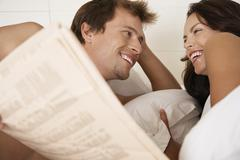 Stock Photo of Couple Looking At Each Other In Bed