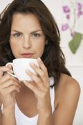 Woman Drinking Cup Of Coffee At Home Stock Photos