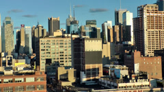 New York 283 Midtown Manhattan, Zoom out from Buildings, Sunset, blue Sky Stock Footage