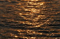 Sunset sea texture Stock Photos