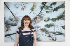 Female Artist Standing In Front Of Large Painting Stock Photos