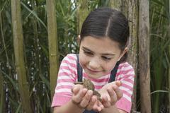 Girl Looking At Toad - stock photo
