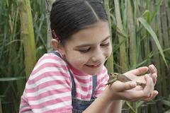 Girl Holding Frog Stock Photos