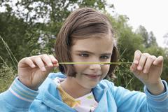 Girl Examining Caterpillar On Grass Stock Photos