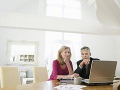 Stock Photo of Woman With Financial Advisor At Table