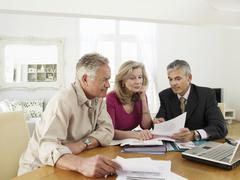 Stock Photo of Couple With Financial Advisor At Table