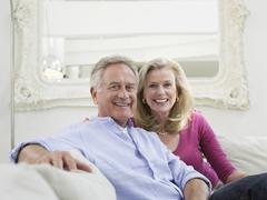 Smiling Mature Couple In White Home Interior Stock Photos