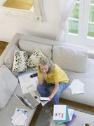 Woman With Financial Documents And Laptop - stock photo