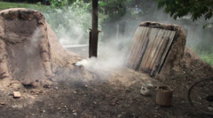 Traditional Charcoal Production - 2 Stock Footage