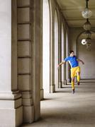 Stock Photo of Soccer Player Kicking Ball In Portico