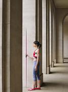 Stock Photo of Female Athlete With Javelin In Portico