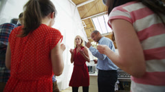 Attractive fun couples showing off their best moves at a house party - stock footage