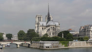 Stock Video Footage of Famous Notre Dame Tour Boat passing Seine River Paris France Ship Moving French