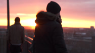 Stock Video Footage of Tourists Are Lookng To Old Tallinn During Golden Hour