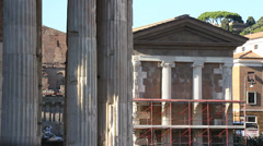 Wide shot photographer next to Temple Portunus in Rome Stock Footage