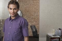 Young Man Standing In Office Stock Photos