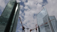 Stock Video Footage of Under Construction Building Crane Blue Sky La Defense Paris Skyline Office Tower