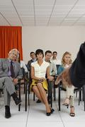 People Listening To Seminar In Conference Room Stock Photos
