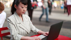 Asian woman using laptop PC computer outdoor working Stock Footage
