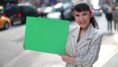 Asian woman holding message board poster green screen Stock Footage