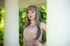 Portrait of a beautiful young woman with long, light brown wig weave and bright  Stock Photos
