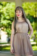 Portrait of a beautiful young woman with long, light brown wig weave and bright  - stock photo